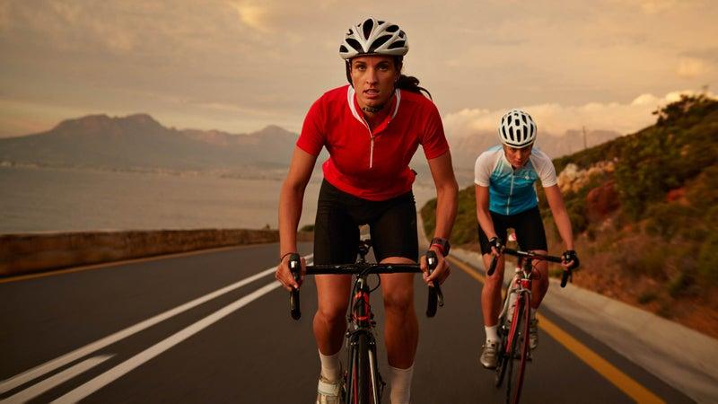 Bike rider accelerating from training partner