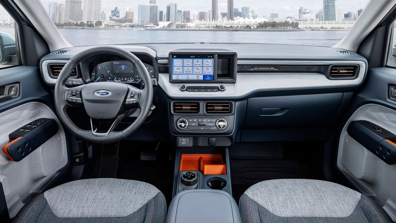 Equipped here with an optional touchscreen center console, the Maverick's interior looks like a genuinely nice place to spend time. The rear seat folds up, revealing a storage bin, and is designed to accommodate a full-size mountain bike with its front wheel removed.