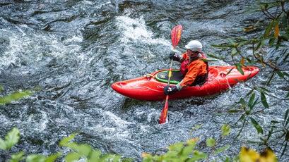 Kayaker navigating the Nantahala River in Natahala Gorge near Bryson City, North Carolina. (USA)