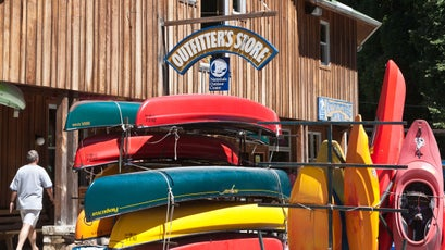 Canoes and kayaks stored outside the Outfitter's Store at the Nantahala Outdoor Center in North Carolina