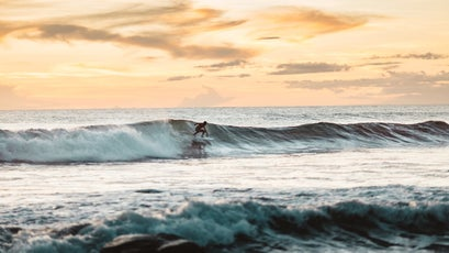 A Surfer Catching A Wave In Nicaragua