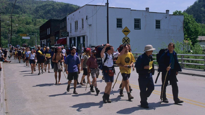 In 1948, Earl Shaffer (wearing the pith helmet) was the first person to complete the entire trail. In this photo he's leading the Trail Festival Parade in Hot Springs, North Carolina, in 1998.