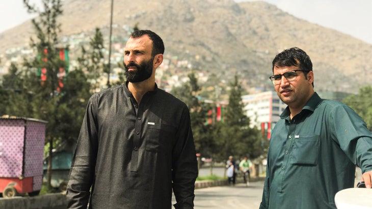 Jason Motlagh and Aziz Tassal taking a break on a Kabul street