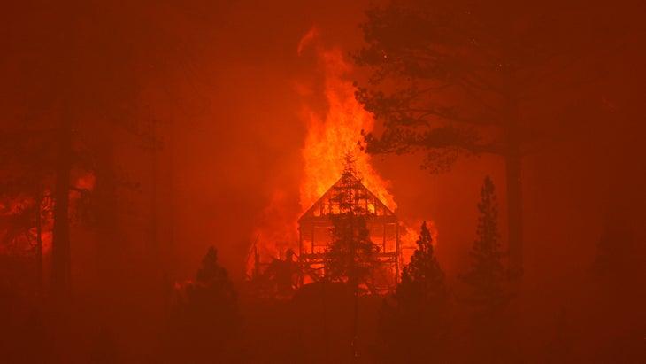The Caldor Fire burns homes along a ridge on August 30, 2021 near South Lake Tahoe, California.
