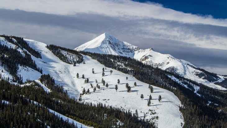 Lone Peak and the surrounding Big Sky Resort covered in snow during November.