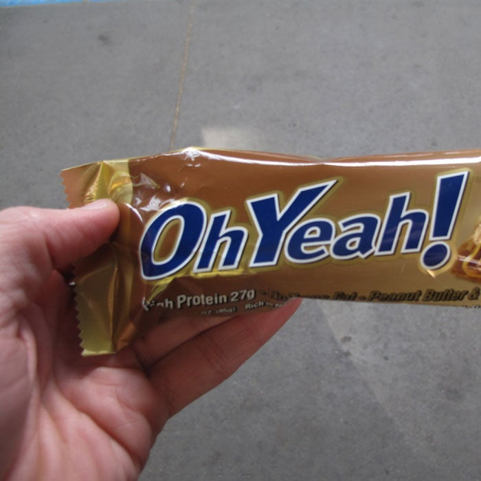 """""""Some protein bars have as much as 8 grams of saturated fat,"""" says Lewin. """"That's like eating a huge cheeseburger!"""" Take, for example, the Oh Yeah! bar, which prides itself on having a """"gooey, candy bar-like taste"""" —thanks to some flavors' 370 calories and 18 grams of fat, 8 of which are saturated. (Think the """"peanut butter and strawberry"""" flavor sounds healthy? It's got the highest saturated fat content of them all:  9 grams.)  """"People are eating these protein bars thinking they're doing something good for their bodies, but they're really filling it with pretty bad stuff,"""" Lewin adds."""