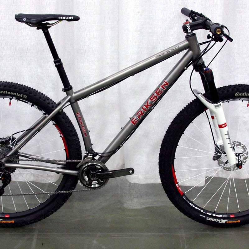 """At less than 22 pounds, Kent Eriksen Cycles' 29er titanium hardtail is built for speed. Welder and elite racer Brad Bingham was touring Italy with a friend in 2009, they discovered a crumbling 1,200 year old school with """"non senza fatica"""" chiseled into the stone. Translation: """"Nothing without effort,"""" a fitting motto for Bingham, who etched it onto the top tube."""