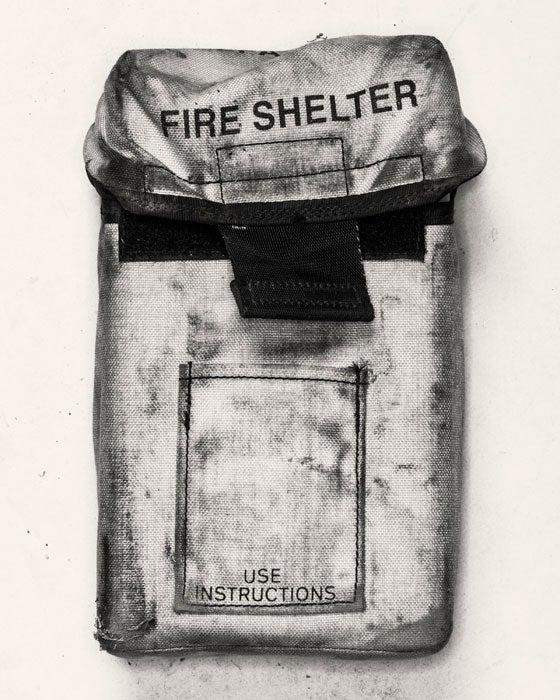 An intact emergency fire shelter