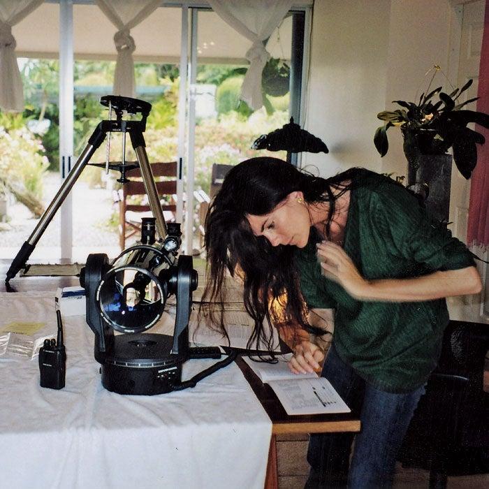 Ann Bender assembling a telescope.