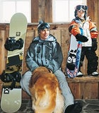 Jake Burton, son Timmy, and Ruby the retriever at home in Stowe, Vermont