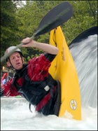 World-renowned kayaker Jimmy Blakeney shows off in the Confluence kayak pool.