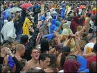 Rain Dance: The crowd can't get enough of the rain or Sheryl Crow.