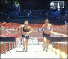 Erica Mitchell and Jamie Cooper sprint up the stairs during Sheryl Crow's sound check.