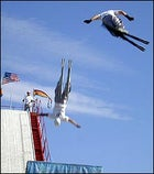 We don't need no stinkin' snow: Tommy DeAngelo and Lance Rouleau fly skyward after making jumps only seconds apart.