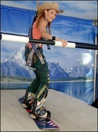 Sheryl Crow carves the day away on the snowboard simulator.