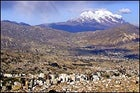 The 21,200-foot Illimani Volcano standing tall above La Paz, Bolivia.