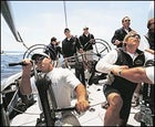 Stars and Stripes: With Ken Read at the helm, Team Dennis Conner launches into a practice race.