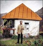 Guide Gela Khutsishvili, outside a forester's cabin at 6,400 feet.