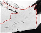 Two hours after the February 1 avalanche (red outline), a probe line of rescuers (center) looks for survivors