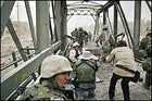 The first wave: Kuni Takahashi (in hat) and Laurent Van Der Stockt document the marine assault on the Diyala Bridge.