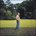 """Schoeffler gazes at the Atchafalaya's Cove Swamp. """"The basin is dying,"""" he says."""