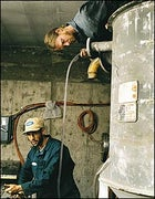 Slippery Hope: biodiesel entrepreneur Charris Ford (bottom), with colleague Nickolai Cowell, at work in their Colorado warehouse