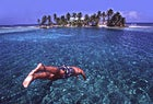 Taking the plunge near Belize's Carrie Bow Caye.