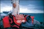 Oakley's Big Smoke Sandal, Mountain Hardwear's long-sleeve Canyon Shirt, Sportif's Convertible Pant, the Rip Curl Aerial watch, Ortlieb Big Zip, Patagonia's Puckerware Shirt, and Merrill's Shoreline Stretch water shoes