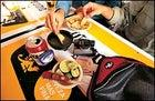 Petzl Zipka Headlamp, Nikon Sportstar III 8x25, Eagle Creek's Pack-It System, and Victorinox Swiss Army Altimeter Knife