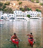 Northwest Passage guides Rick Sweitzer and Mike Agostinelli take a breather in Loutro's port.