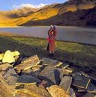 Sacred stones: praying at a Mani Wall beside the Tsangpo River, Tibet