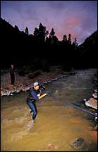 Aggh, That's Cold: A color-coordinated runner wades through the Uncompaghre River.