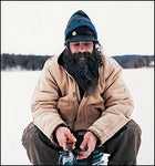 Genuine ring-spun, duck-cloth bliss: local trapper Rick Schiesl ice-fishing near Talkeetna in his Carhartt finest
