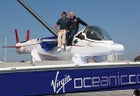 Richard Branson (right) with Chris Welsh atop the Virgin Oceanic.
