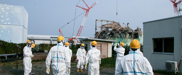 Plant workers attempt to measure radiation levels at the Fukushima Daiichi plant.