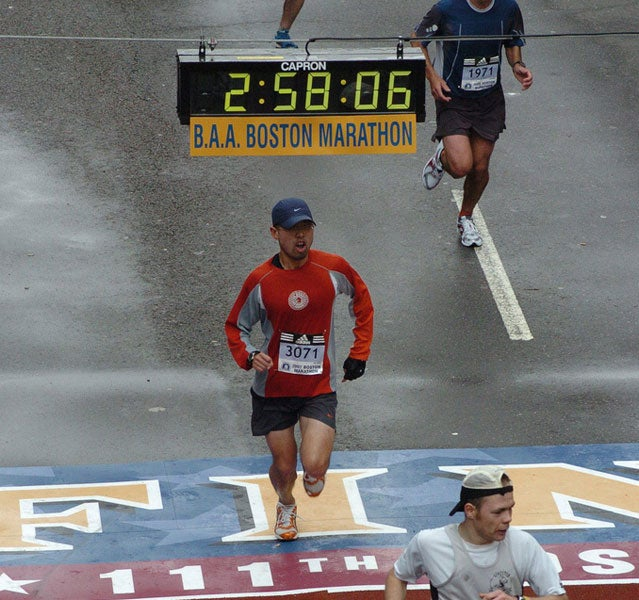 Runners cross the finish line at the 2007 Boston Marathon