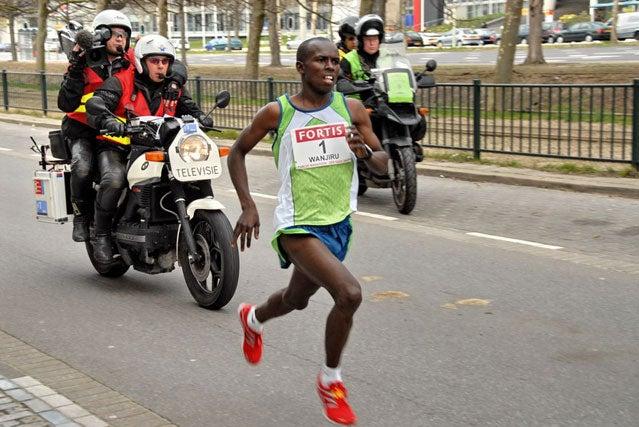 Sammy Wanjiru wins the CPC Den Haag Half Marathon in a then world record of 58:34 in 2007