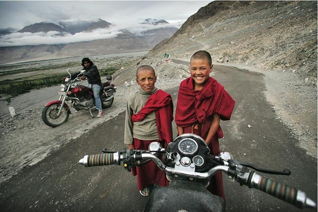 Buddhist monks as seen from a Royal Enfield in Ladakh India