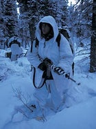Outfitted in arctic camos, an MWTC marine tries to blend in during a covert ambush drill at Fort Greely Military Reservation, Delta Junction, Alaska.