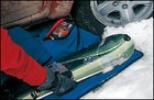 The Burton Cascade SPLT 70 snowboard, the DaKine Dually, and waterproof Smartwool Bacountry Mittens