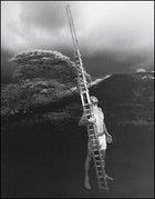 CARRY A BIG STICK: Stone, with a he'e holua sled, in Keauhou, Hawaii