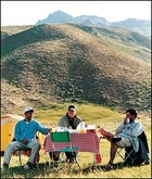 Kicking back in the Elburz: left to right, Shahram, the author, and Abbas Jafari meadow-camping at 9,000 feet.
