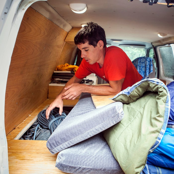 """""""There's extra storage around the wheel wells that's easily accessible from either the trunk or from hidden panels built into the bed. The driver's side compartment holds ropes and skis, while the passenger side holds random camping gear."""""""