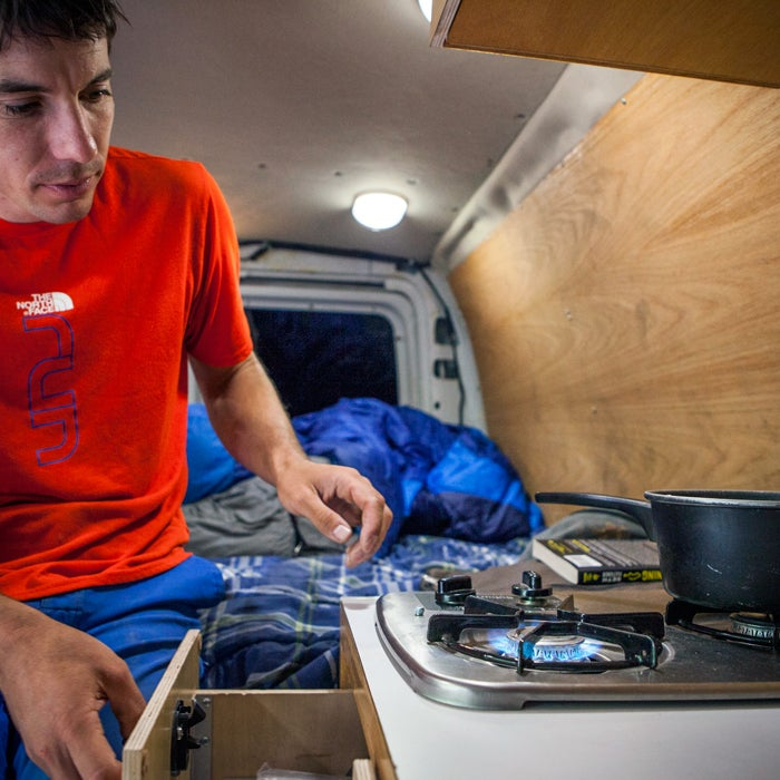 """""""Dinner time! After years of just having a Coleman camp stove bolted to my counter, the newest version of my van is a bit better built."""""""