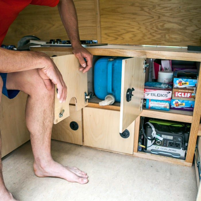 """""""Custom-sized water drawer that keeps my five-gallon jug hidden away. Plus the snack cabinet, with enough Clif product to power me up anything. Notice the Goal Zero batteries hidden down below."""""""