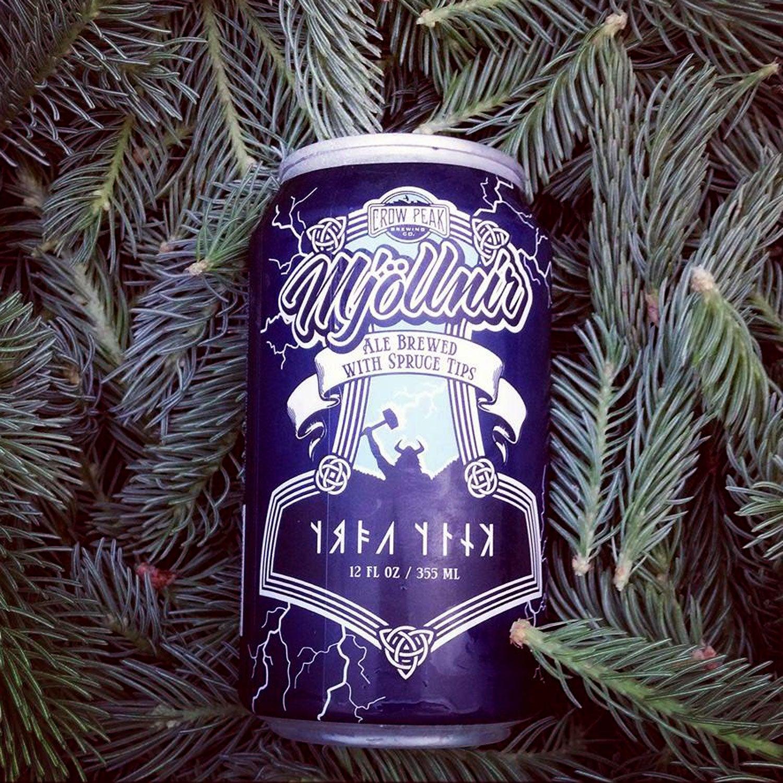 crow peak brewing mjollnir winter canned beer outside