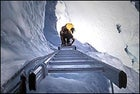 Climbing a ladder on Everest's Khumbu Ice Fall