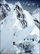 Don't look back; Rick Ridgeway, Foreground, and John Roskelley, members of the first American expedition to summit K2, ascend the northeast ridge in 1978.