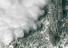 An avalanche rips down a mountainside.