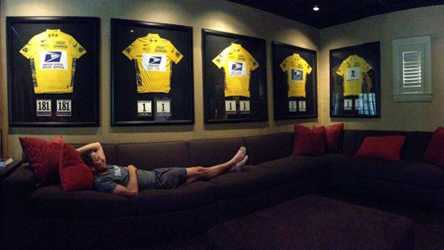 Lance Armstrong with his yellow jerseys.